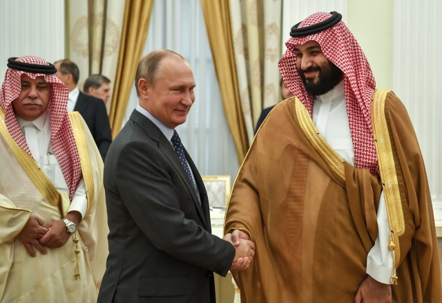 Vladimir Putin (left), shakes hands with Saudi Arabian Crown Prince Mohammed bin Salman,  during their meeting in Moscow, Russia.