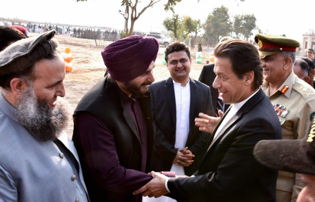 Pakistan Prime Minister Imran Khan shakes hands with Navjot Singh Sidhu during inauguration ceremony for Kartarpur corridor in Pakistan on Wednesday, 28 November.