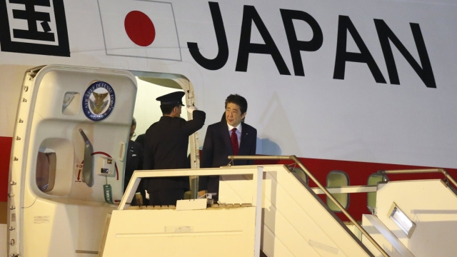 Japan's Prime Minister Shinzo Abe arrives at the Ministro Pistarini international airport in Buenos Aires, Argentina.