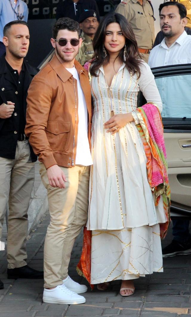 Nick Jonas and Priyanka Chopra pose for shutterbugs.