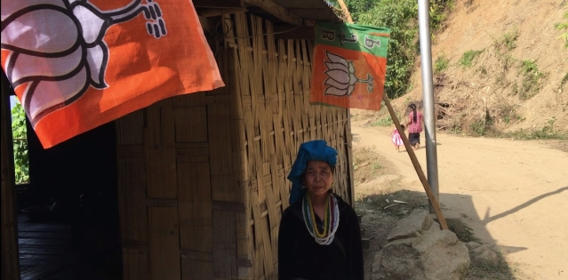 Janaki has BJP flags at the entrance to her house.