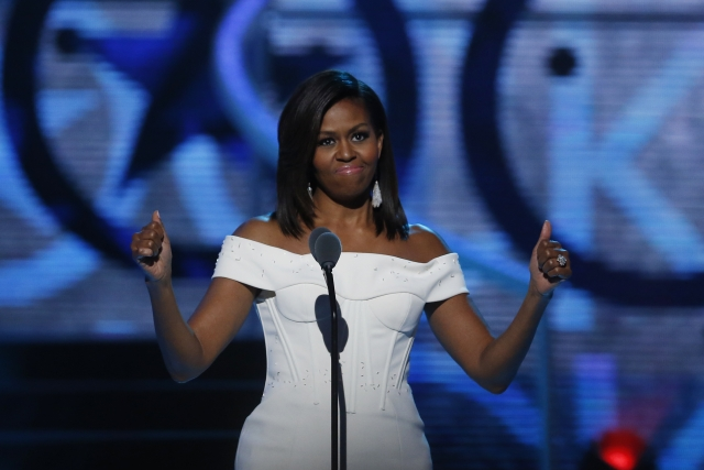 """As the first black first lady, Michelle said she knew she would be labeled """"other"""" and would have to earn the aura of """"grace"""" given freely to her white predecessors."""