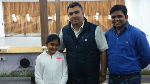Esha Singh with Olympic medallist Gagan Narang (centre).