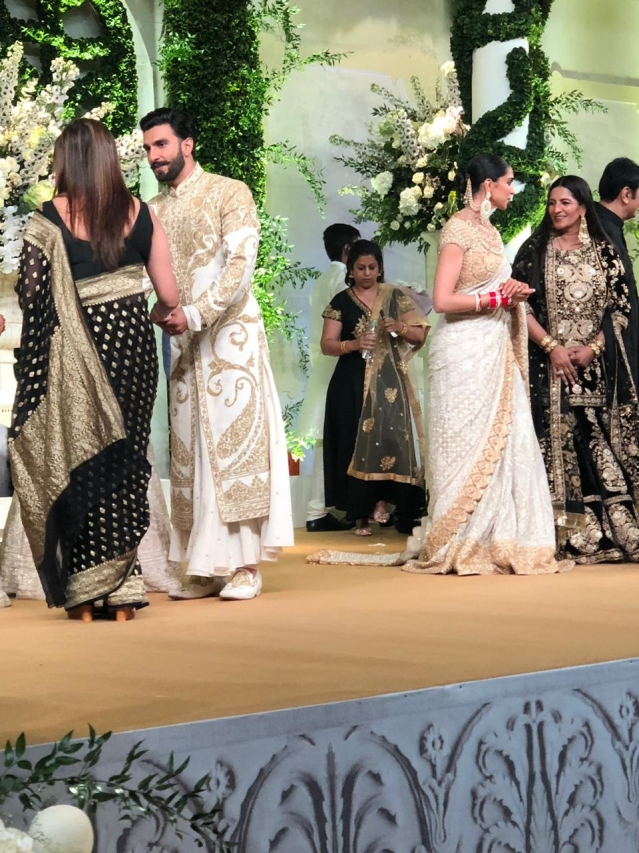 Ranveer Singh and Deepika Padukone are busy talking to the guests.