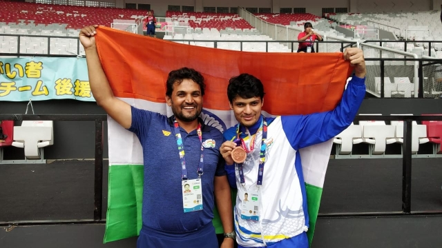Avnil Kumar (left) with coach Dr Satyapal Singh after winning bronze in the men's 400m  in the T13 category at Para Asian Games 2018 in Jakarta.