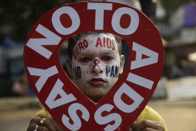 Ahead of the World Aids Day on 1 December, an activist holds a prop during an awareness campaign  in Kolkata, on Friday 30 November.