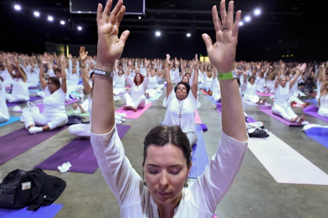 Attendants stretch during a Yoga for Peace event led by Prime Minister Narendra Modi at La Rural Convention Center in Buenos Aires, Argentina.