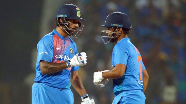 Shikhar Dhawan, left, and Rishabh Pant interact in the middle during the third T20I against West Indies.