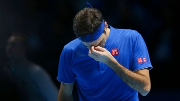 Roger Federer is dejected after losing a point against Alexander Zverev in the ATP Finals semis.