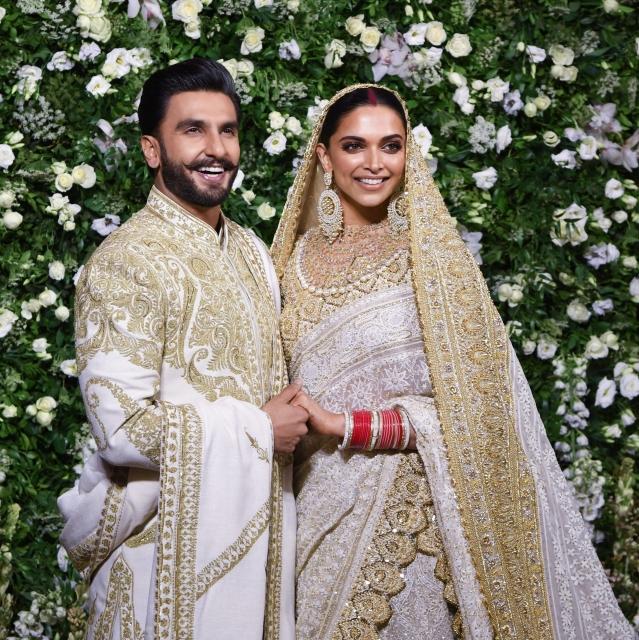 Actors Ranveer Singh and Deepika Padukone at their wedding reception in Mumbai on Wednesday, 28 November.