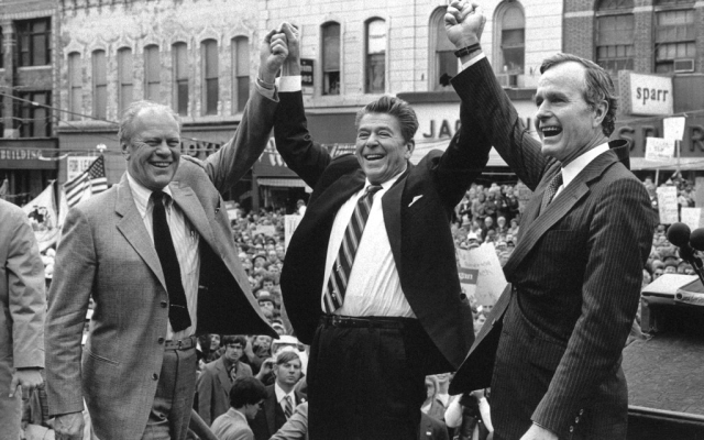 In this 1980 photo, former President Gerald Ford lends his support to Republican presidential candidate Ronald Reagan and his running mate, George HW Bush in Peoria, Illinois.