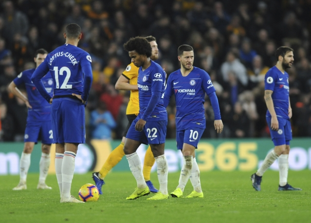 Chelsea players look deflated after conceding a second goal during their defeat to Wolverhampton Wanderers in the Premier League.