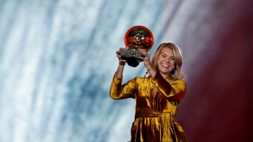 Norway's Ada Hegerberg celebrates with the Women's Ballon d'Or award during the Golden Ball award ceremony at the Grand Palais in Paris on Monday, December 3, 2018.