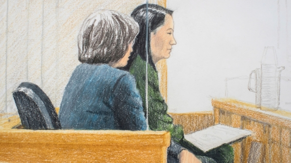 In this courtroom sketch, Meng Wanzhou (right), the chief financial officer of Huawei Technologies, sits beside a translator during a bail hearing at British Columbia Supreme Court in Vancouver.
