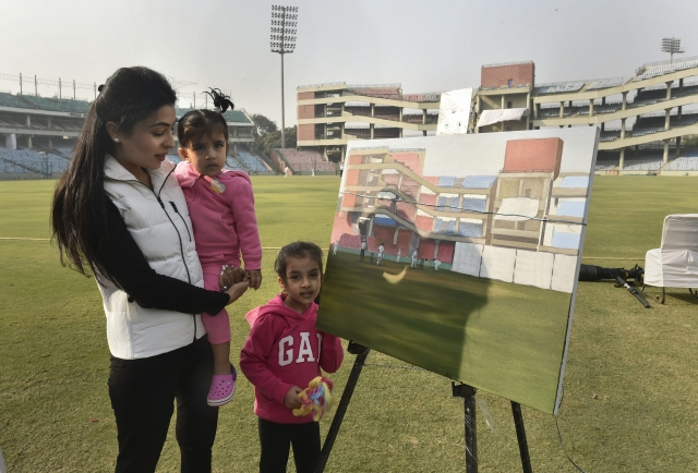 Gautam Gambhir's wife Natasha and daughters with a painting by Saif.