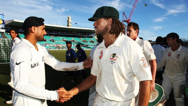 Harbhajan Singh and Andrew Symonds shaking hands after the controversial Sydney Test of 2008.
