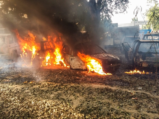 Vehicles set on fire by a mob during a protest over the alleged illegal slaughter of cattle.