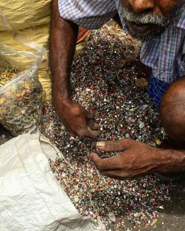 Stones and imitation jewellery being sorted to be reused at Zaveri Bazaar