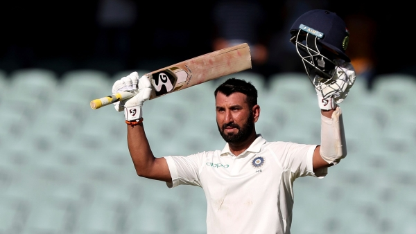 Cheteshwar Pujara celebrates after reaching a century on Day 1 of the first Test between Australia and India at Adelaide.