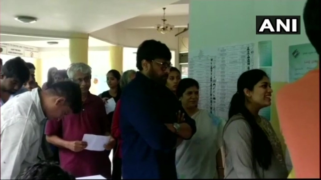Actor Chiranjeevi stands in a queue to cast his vote at polling booth number 148 in Jubilee Hills, Hyderabad.