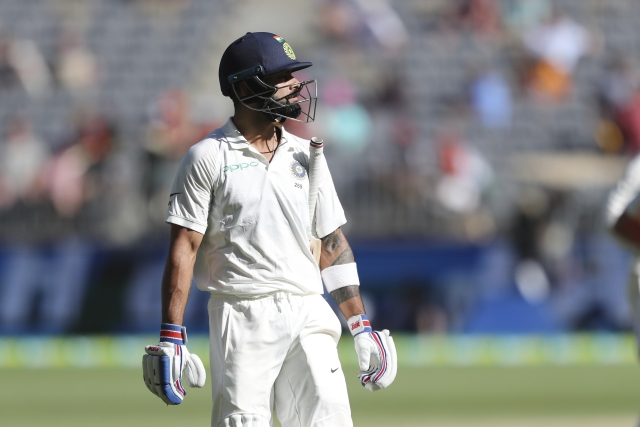 Virat Kohli walks off after being dismissed in India's second innings during the Perth Test against Australia.