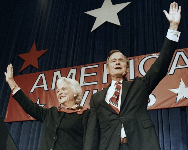 In this 1988 photo, President-elect George HW Bush and his wife Barbara wave to supporters in Houston, Texas after winning the presidential election.