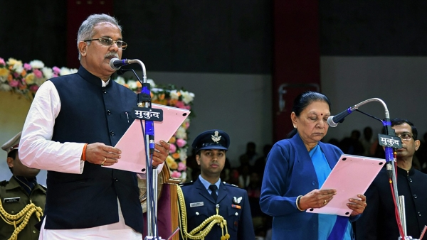Chhattisgarh Chief Minister Bhupesh Baghel being administered the oath of office by Governor Anandiben Patel during a swearing-in ceremony, in Raipur.
