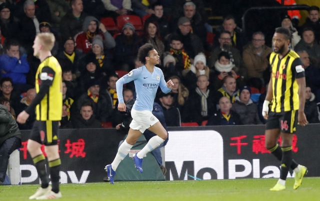Manchester City's Leroy Sane, center, celebrates after scoring his side's opening goal during the English Premier League soccer match between Watford and Manchester City.