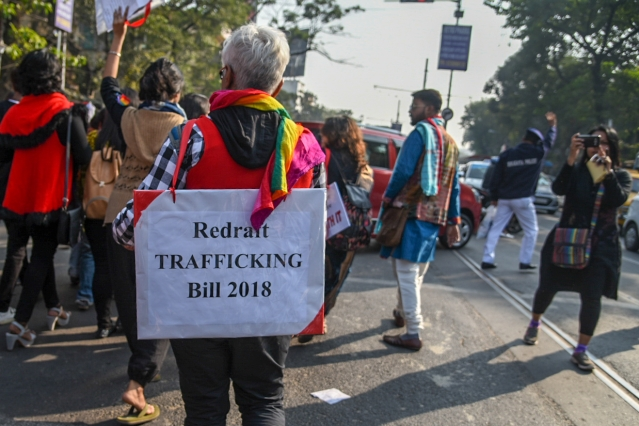 A protester dons a placard opposing the Trafficking Bill 2018