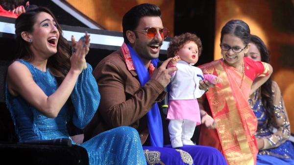 Sara Ali Khan and Ranveer Singh seem to be sharing joke on the Taimur doll.