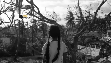 A young girl named Kavishri overlooks the damage caused to her house by Cyclone Gaja.