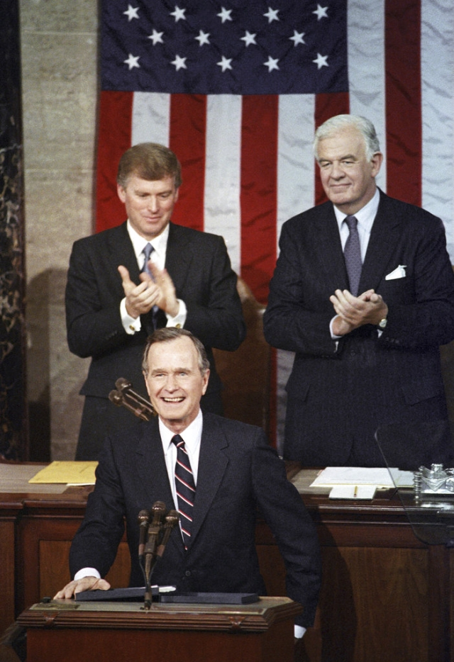 In this 1990 photo, President George HW Bush receives applause from Vice President Dan Quayle (left) and House Speaker Thomas Foley prior to delivering his first State of the Union address on Capitol Hill in Washington.