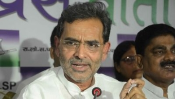 Minister of State for HRD Upendra Kushwaha addresses a press conference.