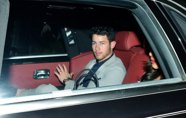 Nick Jonas waves to the paps as he returns with PeeCee to Mumbai.