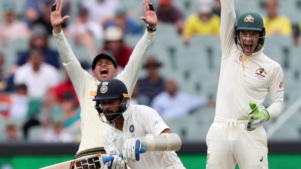 Australian captain Tim Paine (right) appeals for the wicket of Murali Vijay (center) during the first Test vs India at Adelaide.