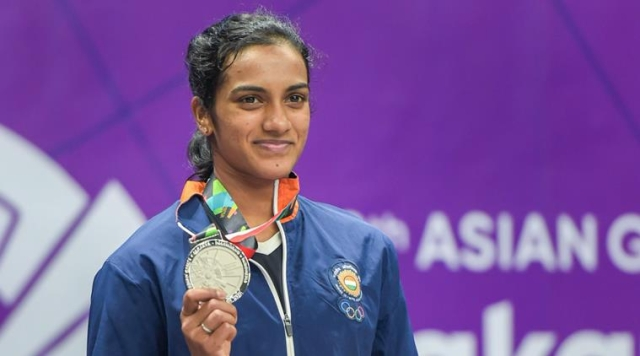 PV Sindhu, seen here posing with her 2018 Asian Games silver medal, had lost six successive major finals since 2016.