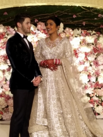 New Delhi: Actress Priyanka Chopra and her husband American singer Nick Jonas at their wedding reception in New Delhi on Dec 4, 2018. (Photo: IANS)