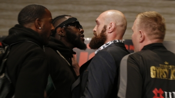 Boxers Deontay Wilder, second from left, and Tyson Fury, center, exchange words as they face each other at a news conference in Los Angeles, Wednesday, Nov. 28, 2018. The pair are slated to fight Saturday night for Wilder's WBC heavyweight title.