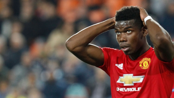 Manchester United's Paul Pogba reacts after missing a chance to score during a Group H Champions League soccer match.
