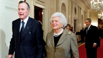 In this 2009 photo, former US President George HW Bush walks with his wife, former first lady Barbara Bush, followed by their son, President George W Bush, and his wife first lady Laura Bush, to a reception in honour of the Points of Light Institute, in the East Room at the White House in Washington.