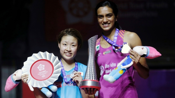 PV Sindhu and Nozomi Okuhara (left) at the trophy presentation after the BWF World Tour Finals at Guangzhou, China.