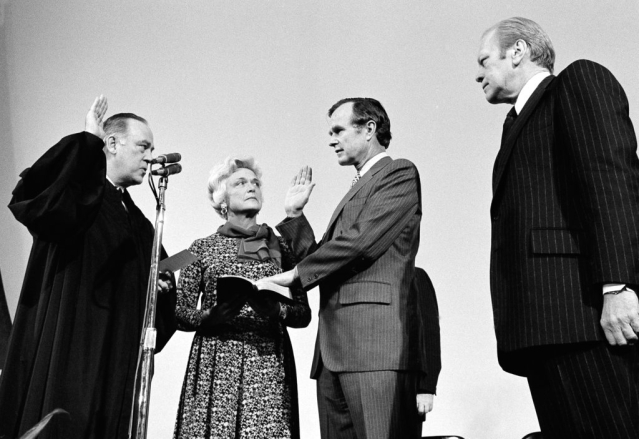 George HW Bush is sworn in as director of the Central Intelligence Agency by Supreme Court Associate Justice Potter Stewart, left, as Barbara Bush and President Gerald Ford, look on at CIA headquarters.