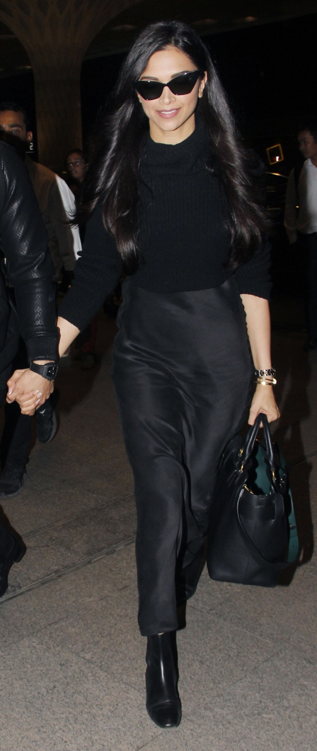 Deepika wore a black turtle-neck sweater with leggings
