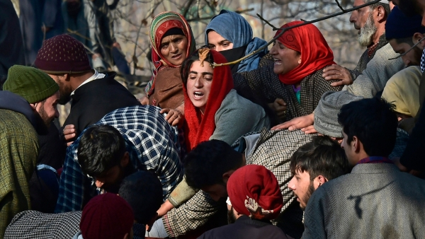 Villagers wail while attending the funeral of civilians and militants who were killed in the encounter between security forces and militants, in Pulwama, south Kashmir.