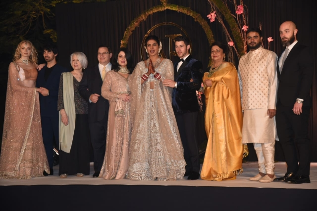 The Chopra and Jonas families share a stage.