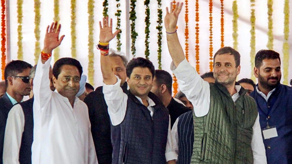 President Rahul Gandhi (R) with newly-sworn in Madhya Pradesh Chief Minister Kamal Nath (L) and party MP Jyotiraditya Scindia wave at the crowd during swearing-in-ceremony.