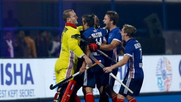 French hockey players celebrate a goal during their 5-3 win over Argentina in the Hockey World Cup.