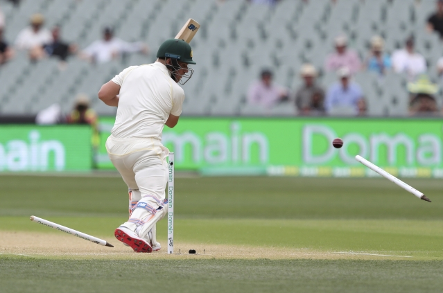 Australia's Aaron Finch is bowled for no score during the first cricket Test between Australia and India in Adelaide.