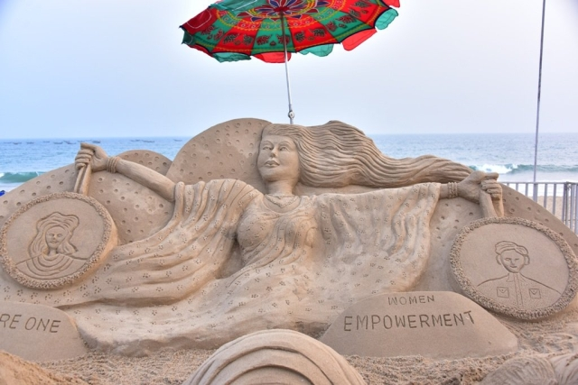 A women's empowerment themed sand sculpture.