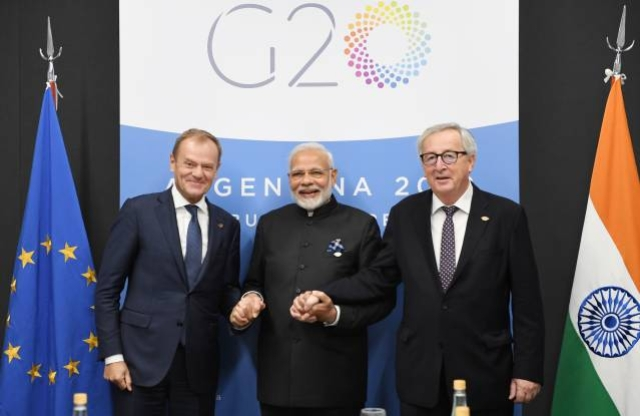 Prime Minister Narendra Modi meets the Jean-Claude Juncker and Donald Tusk, in Buenos Aires.